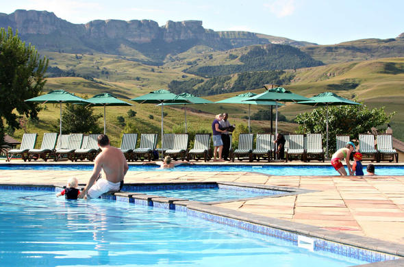 Swimming pool area with stunning mountain views.