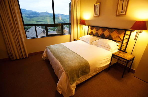 Room interior with stunning mountain views at Alpine Heath Resort.