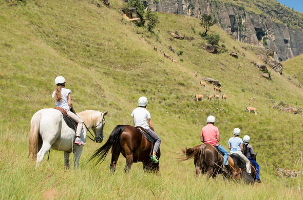 Guests exploring the Drakensberg on a horse ride.