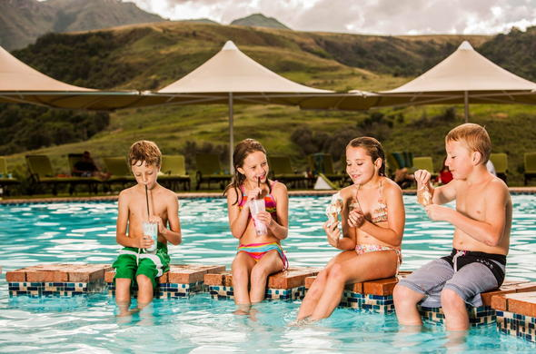 Kids enjoy treats at the pool side.