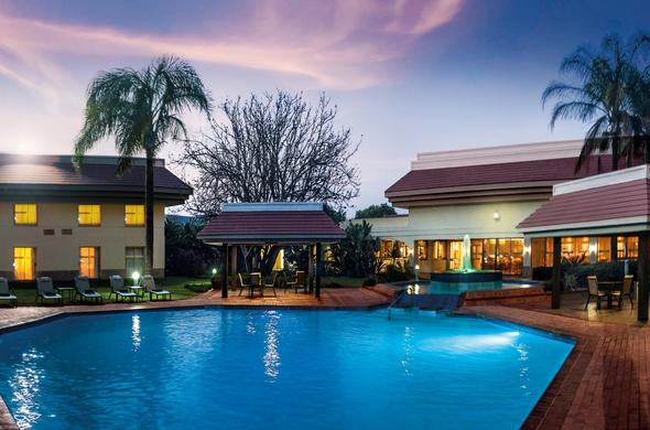 Garden Court Ulundi swimming pool area at night.