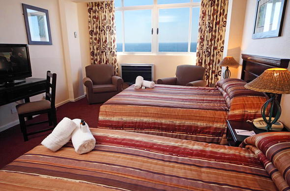 Hotel bedroom with seaviews.
