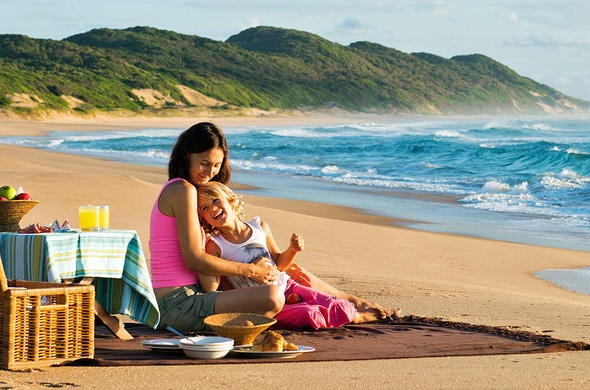 Family enjoying a lovely picnic at the beach.