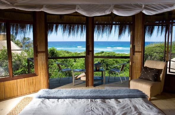 Comfortable bedroom with sea-views.